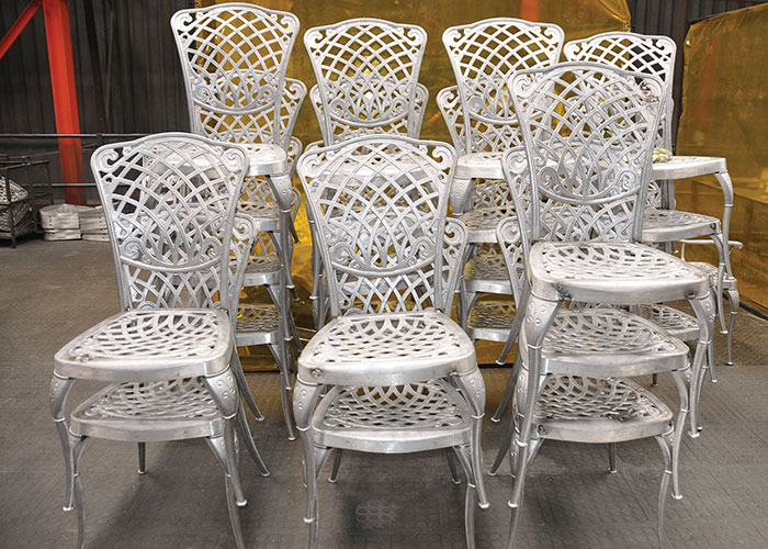 Aluminium chairs that have been fettled and welded before being sent for powder coating